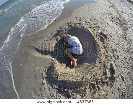 Girl hiding on the sea shore