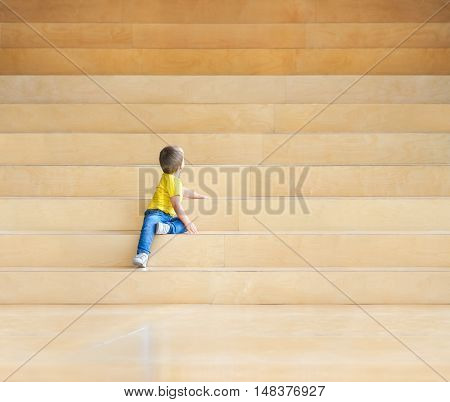 child on the stairs, symbol of growth and development