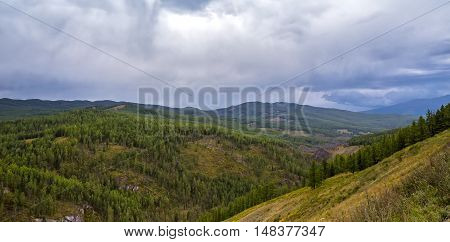 green forest mountains pass Ulaganskiy. Altai Russia