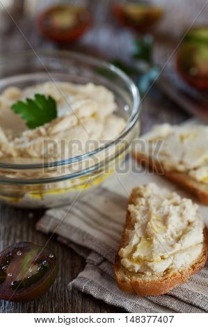 Delicious snack from crostini with chicken pate or paste and tomatoes, selective focus.