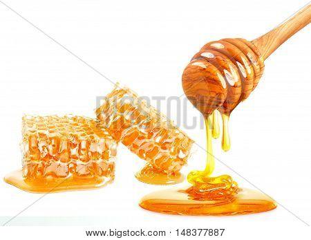 dripping honey on honeycomb isolated on white background