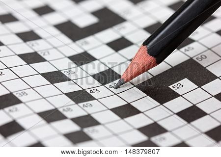 Сrossword puzzle and pencil. Popular logic and educational hobby game.