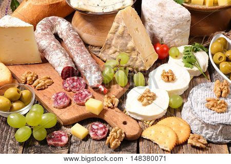 composition with cheese,meat and grape