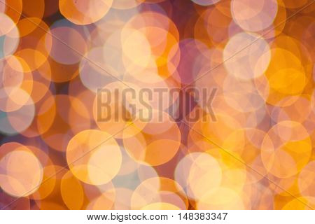 Christmas shiny bokeh in yellow golden colors, new year illunination. Seasonal holiday background.