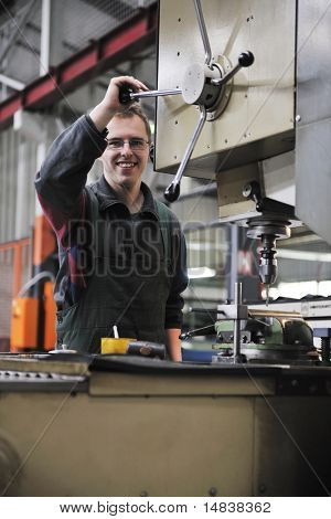 engineering people manufacturing industry with big modern computer machines