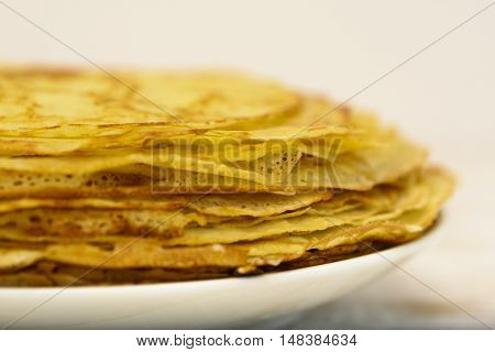 Pancakes with oil. Traditional Russian pancakes close-up .