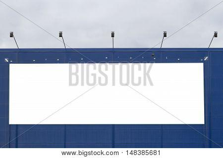 Mock up. Empty horizontal billboard screen on the wall.
