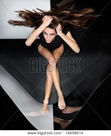 Young Slim Beautiful Lady With Long Hairs Running In Abstract Plastic Tube, Ring Flash Fashion Portr