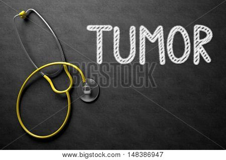 Tumor. Medical Concept, Handwritten on Black Chalkboard. Top View Composition with Chalkboard and Yellow Stethoscope. Medical Concept: Black Chalkboard with Tumor. 3D Rendering.