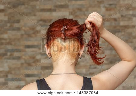 young model with colored tail and hidden undercut bleached hair