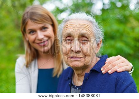 Picture of an old lady with her granddaughter