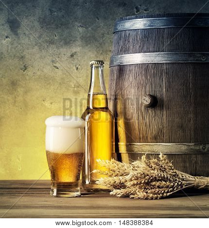 Wooden barrel with ears and glass of beer tinted in yellow and blue