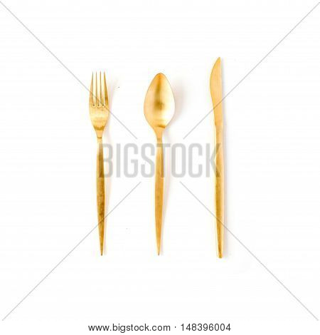 golden fork spoon knife isolated on white. flat lay top view