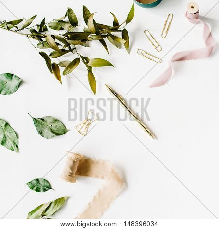 feminine home office workspace mockup with branches golden pen clips and beige ribbon. flat lay top view