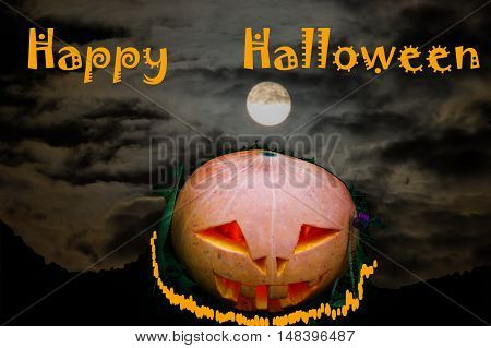 Scary pumpkin on Halloween on the moon background and text clouds