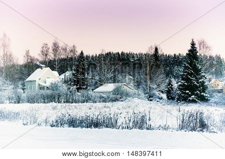 View of small swedish european town Soderhamn at pink sunset, winter seasonal background