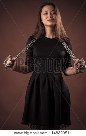 Korean smiling teenager girl with chain in hands