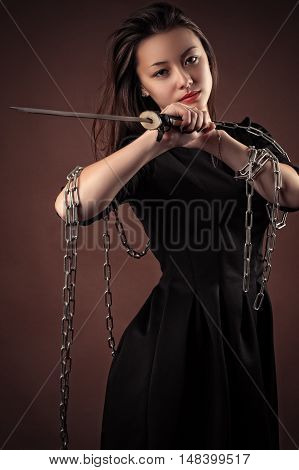 brutal korean girl with sword in hands