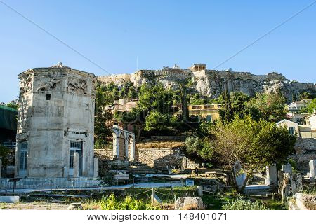 The Tower of the Winds in Ancient Agora and the rock of Acropolis in AthensGreece