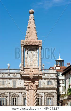 Ancient marble column with small shrine (1401) with bas-relief of San Zeno (St. Zeno) in Piazza delle Erbe in Verona - Veneto Italy