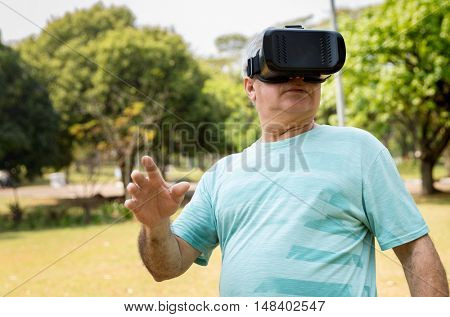 Senior wearing virtual reality goggles outside
