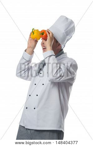 chef holding two peppers and looking into them