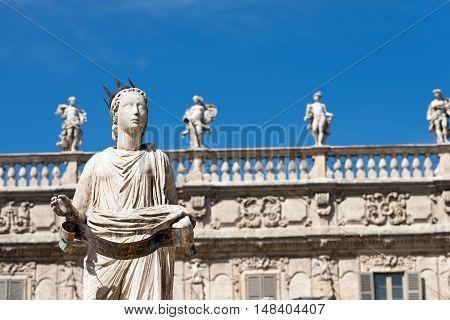 Detail of the fountain in Piazza delle Erbe with the statue of Madonna Verona in Verona (UNESCO world heritage site) Veneto Italy