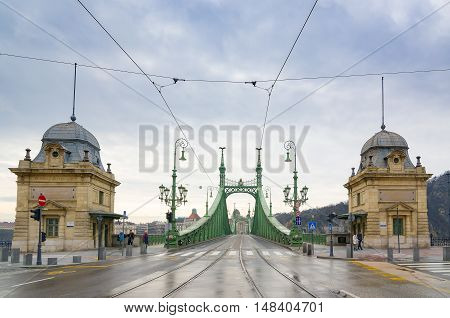 BUDAPEST, HUNGARY - FEBRUARY 21, 2016: Liberty Bridge or Freedom Bridge in Budapest, Hungary connects Buda and Pest across the River Danube.