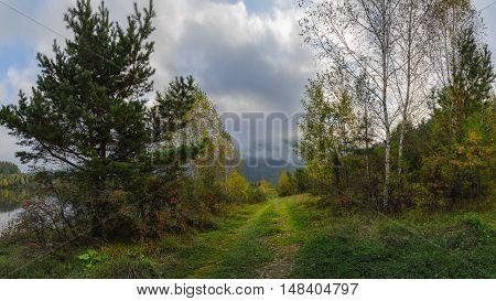 Cloudy autumn month of September in Sayan taiga. Khakassia Siberia.