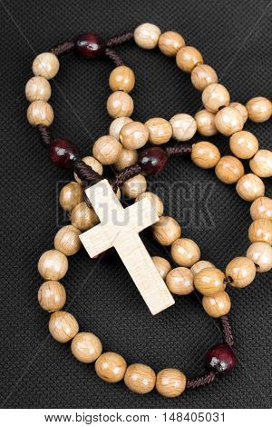 closeup of a rosary on a dark background