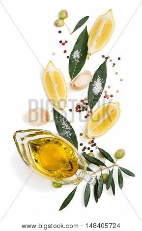 Top view of olive oil spices and slices of lemon decorated with olive fruits. Isolated on white background.