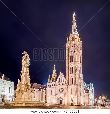 Night view of the Matthias Church and Statue of Holy Trinity in Budapest, Hungary. HDR image.