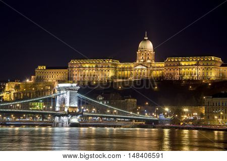 Night view of the illuminated Buda Castle and The Szechenyi Chain Bridge, Budapest, Hungary.