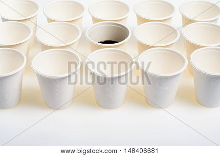 Few Glasses of Environmentally Friendly Paper that having in its Surface a beautiful Texture and a beverage can in the middle photographed from above to make a flat lay composition