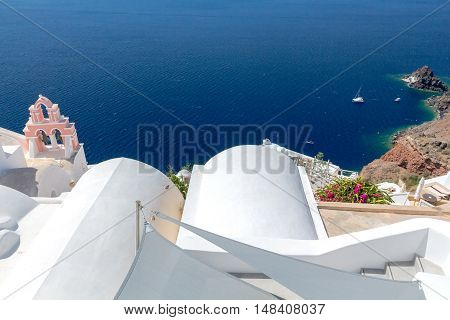 View on Oia village with traditional blue and white houses.