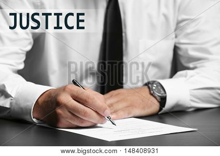 JUSTICE.  Man working in office