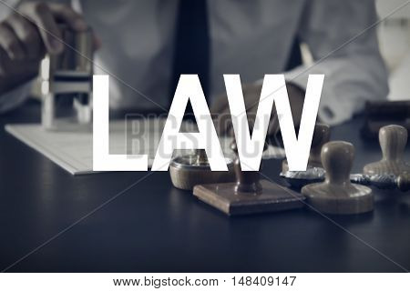LAW. Wooden and metal stamps on notary public table