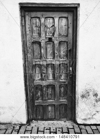 Wooden door in the middle of the city in a old building. (Iasi, Romania)