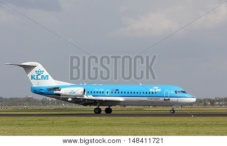 Schiphol Airport the Netherlands - August 20 2016: KLM Air France fokker 70 cityhopper landing