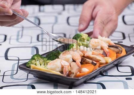 Chef decorated stir fry vegetables on plate / Stir fry Broccoli concept