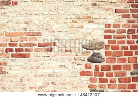 Destroyed and renovated brick wall texture. Different types of bricks forming grunge texture. Can be also used like background.