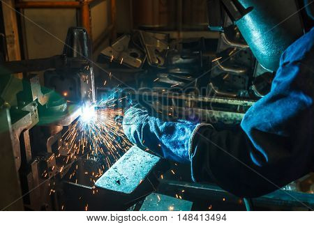 Employee welding  Industrial automotive part in car production factory