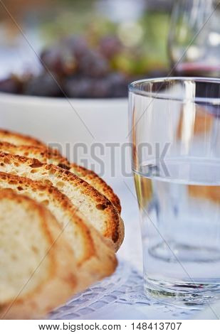 Loaf of Bread and Glass of Water
