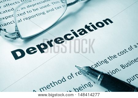Paper with sign Depreciation and a pen. Business concept.