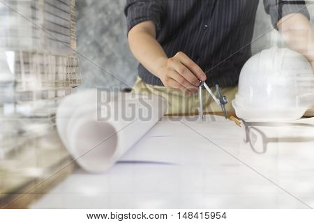 Architect or engineer working in office Construction concept. Engineering tools.Vintage tone retro filter effect soft focus(selective focus).