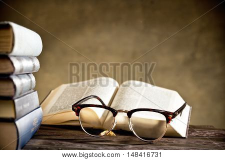 still life with eyeglasses and books on the table
