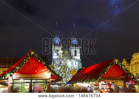 Old Town Square with Christmas tree and fairy tale Church of our Lady Tyn in the magical city of Prague at night, Czech Republic