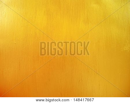 Gold metallic paint on steel texture background