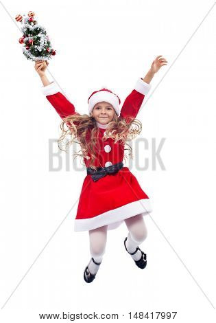 Little santa helper girl jumping with small christmas tree - isolated
