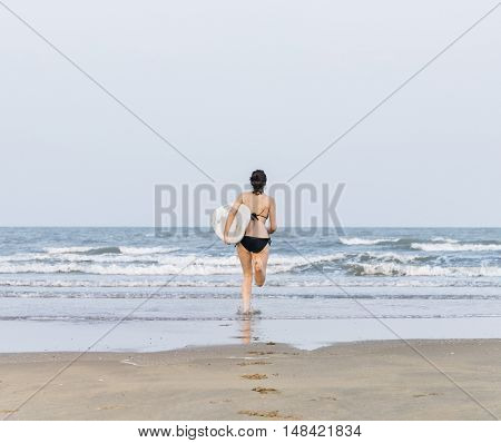 Woman Beach Summer Holiday Vacation Surfing Concept